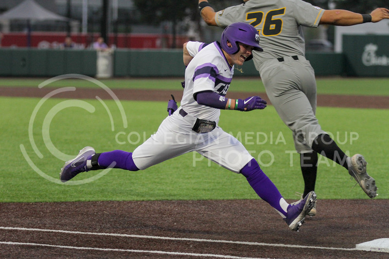 Sophomore Blake Burrows stretches out to reach first base before a Missouri player attempts to catch the ball during the April 27, 2021 game against Missouri at Tointon Family Stadium. (Sophie Osborn | Collegian Media Group)