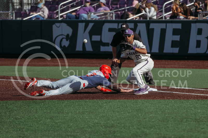 Sophomore infielder Daniel Carinci attempts to tag out a New Mexico player during the game on March 20, 2021 against New Mexico at Tointon Family Stadium. ( Sophie Osborn   Collegian Media Group)