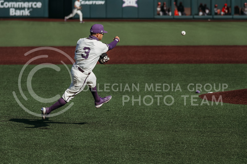 Senior Cameron Thompson throws the ball towards first during the game on March 20, 2021 against New Mexico at Tointon Family Stadium. ( Sophie Osborn   Collegian Media Group)