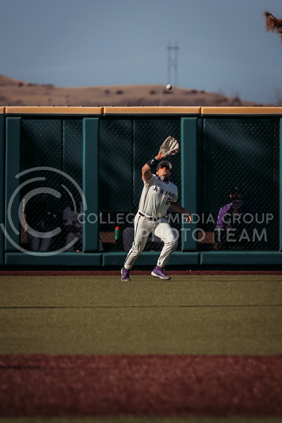 Junior Jaxon Passino watches the ball before catching it during the game on March 20, 2021 against New Mexico at Tointon Family Stadium. ( Sophie Osborn   Collegian Media Group)