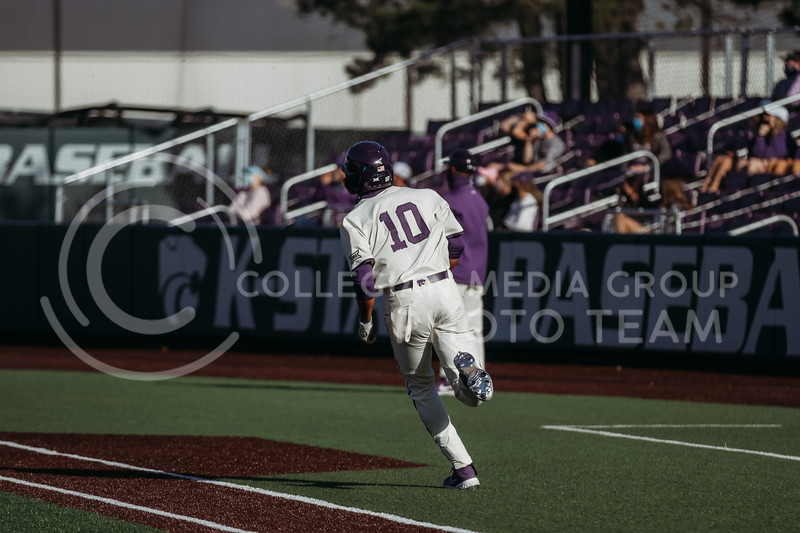 Junior Kamron Willman runs towards first base during the game on March 20, 2021 against New Mexico at Tointon Family Stadium. ( Sophie Osborn   Collegian Media Group)
