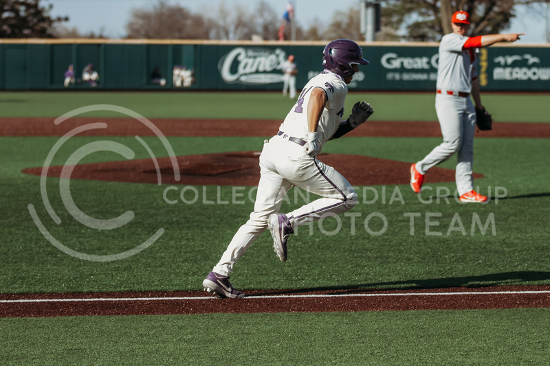 Junior catcher Dylan Caplinger runs towards first during the game on March 20, 2021 against New Mexico at Tointon Family Stadium. ( Sophie Osborn   Collegian Media Group)