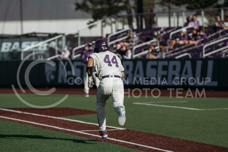 Junior catcher Dylan Caplinger runs towards first base during the game on March 20, 2021 against New Mexico at Tointon Family Stadium. ( Sophie Osborn   Collegian Media Group)