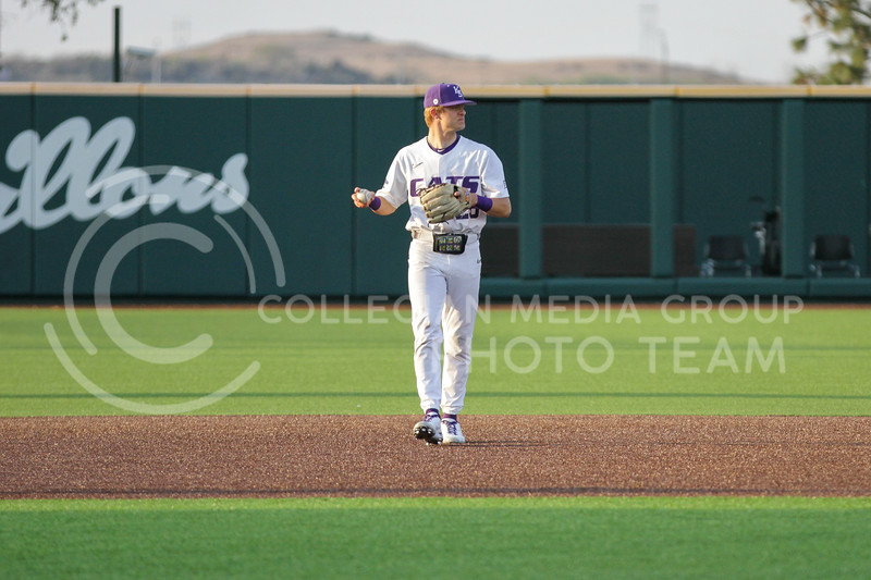 Junior Zach Kokoska holds the ball in the outfield during the April 13, 2021 game against Northern Colorado at Tointon Family Stadium. (Sophie Osborn | Collegian Media Group)