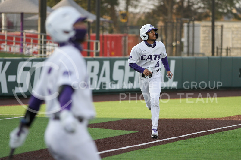 Junior Kamron Willman eyes the ball on his way to homeplate during the April 13, 2021 game against Northern Colorado at Tointon Family Stadium. (Sophie Osborn | Collegian Media Group)