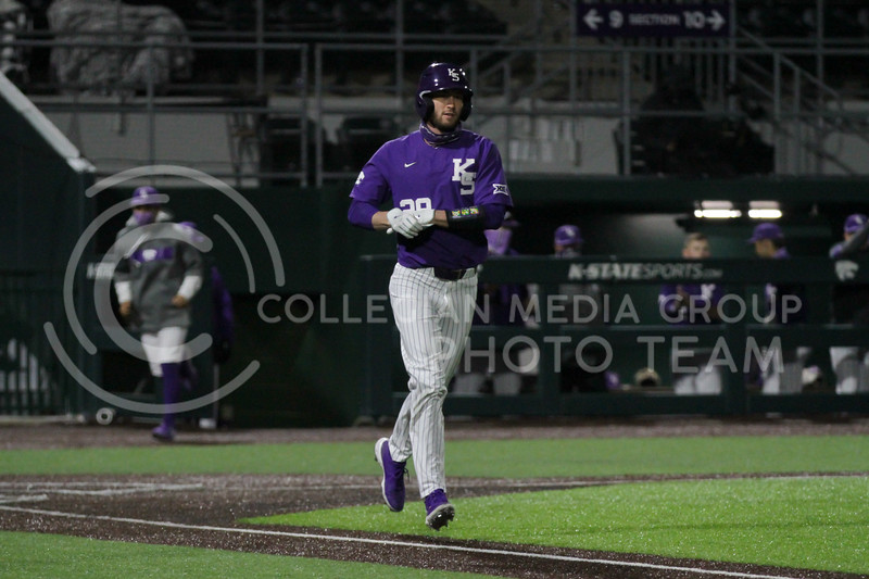 Junior Austin Garrett heads toward first after getting a walk during the April 14, 2021 game against Northern Colorado at Tointon Family Stadium. (Sophie Osborn | Collegian Media Group)