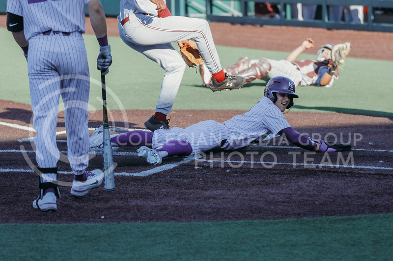 Sophomore Blake Burrows slides into home plate during the April 30, 2021 game against Texas Southern at Tointon Family Stadium. (Sophie Osborn   Collegian Media Group)