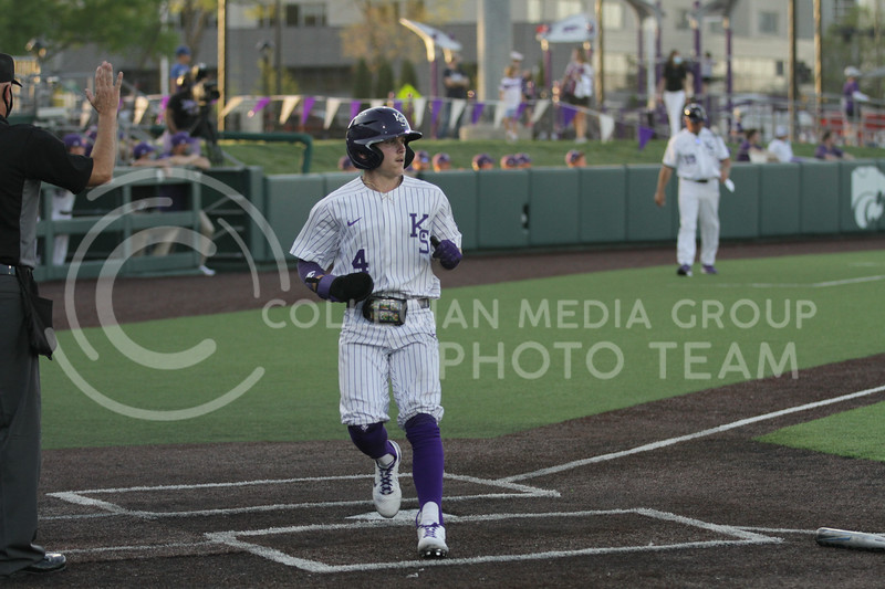 Sophomore Blake Burrows runs through home plate during the April 30, 2021 game against Texas Southern at Tointon Family Stadium. (Sophie Osborn   Collegian Media Group)
