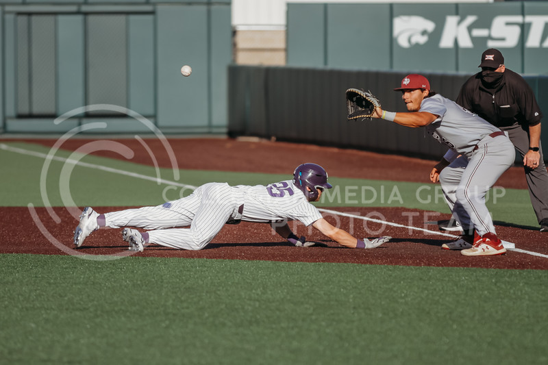 Freshman Nick Goodwin dives back to first base after attempting to steal a base during the April 30, 2021 game against Texas Southern at Tointon Family Stadium. (Sophie Osborn   Collegian Media Group)