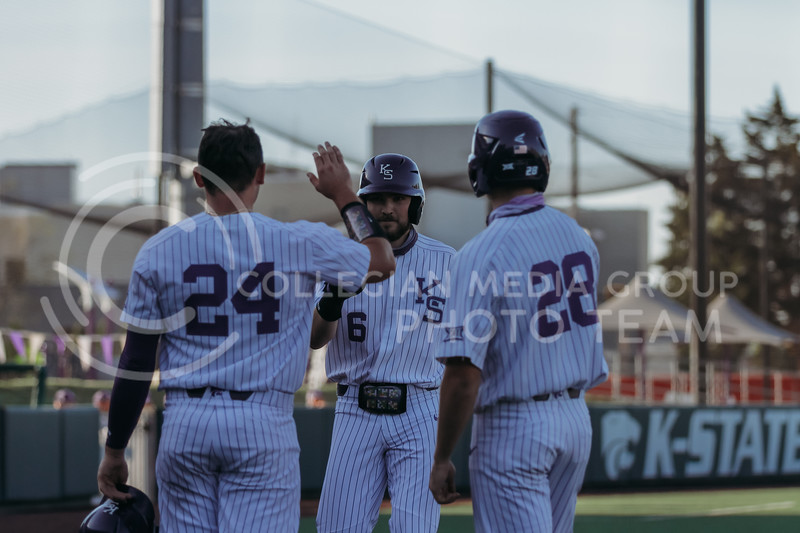 Teammates celebrate success during the April 30, 2021 game against Texas Southern at Tointon Family Stadium. (Sophie Osborn   Collegian Media Group)