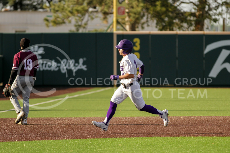 Sophomore Blake Burrows runs to third base during the May 1, 2021 game against Texas Southern at Tointon Family Stadium. (Sophie Osborn | Collegian Media Group)
