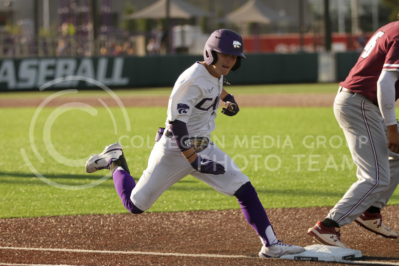 Sophomore Blake Burrows hits first base during the May 1, 2021 game against Texas Southern at Tointon Family Stadium. (Sophie Osborn   Collegian Media Group)