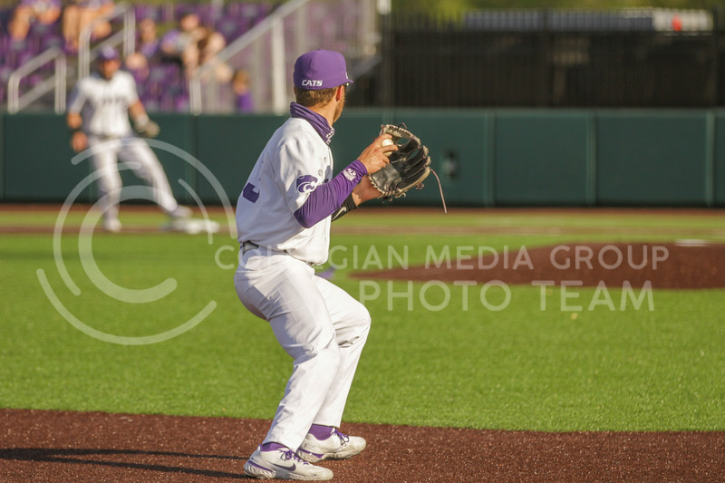 Senior Cameron Thompson looks to throw the ball to first base during the May 1, 2021 game against Texas Southern at Tointon Family Stadium. (Sophie Osborn | Collegian Media Group)
