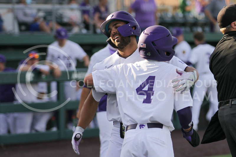 Sophomore Blake Burrows congratulates Sophomore Daniel Carinci on a home run during the May 1, 2021 game against Texas Southern at Tointon Family Stadium. (Sophie Osborn | Collegian Media Group)