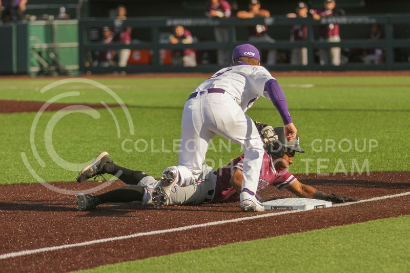 Senior Cameron Thompson tags a runner out during the May 1, 2021 game against Texas Southern at Tointon Family Stadium. (Sophie Osborn | Collegian Media Group)