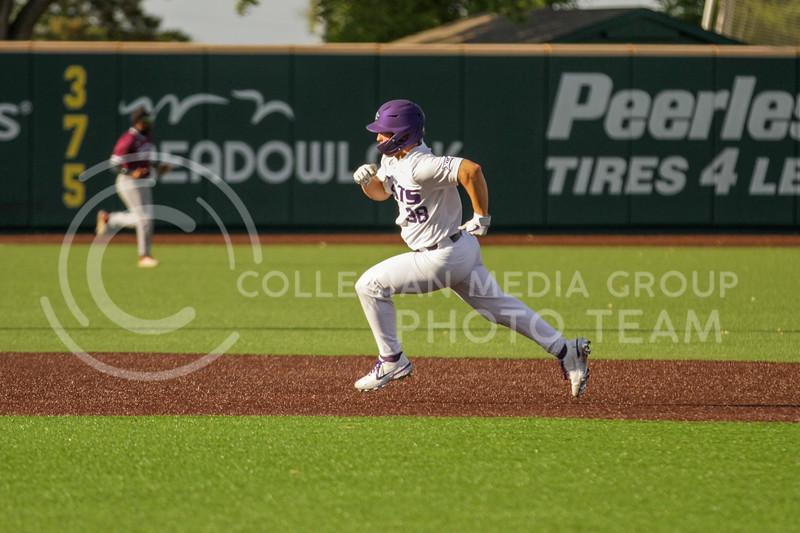 Junior Austin Garrett runs towards third base during the May 1, 2021 game against Texas Southern at Tointon Family Stadium. (Sophie Osborn | Collegian Media Group)