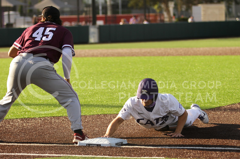 Freshman Nick Goodwin dives back to first base