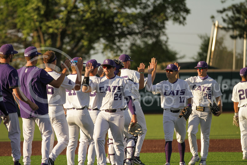 Teammates celebrate after the May 1, 2021 game against Texas Southern at Tointon Family Stadium. (Sophie Osborn | Collegian Media Group)