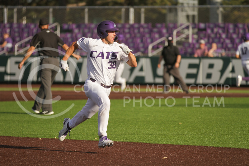 Junior Austin Garrett runs to third base during the May 1, 2021 game against Texas Southern at Tointon Family Stadium. (Sophie Osborn | Collegian Media Group)