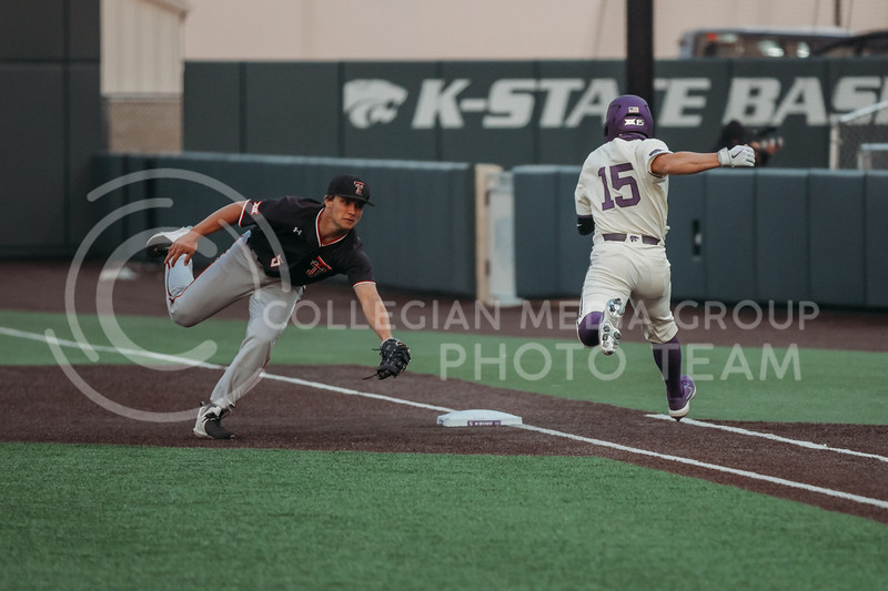 Freshman Luke Beckstein attempts to make it towards first during the first game against Texas Tech on April 1, 2021. (Sophie Osborn   Collegian Media Group)