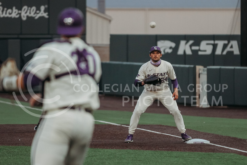Sophomore Dylan Phillips looks to catch the ball and tag out a runner during the first game against Texas Tech on April 1, 2021. (Sophie Osborn   Collegian Media Group)