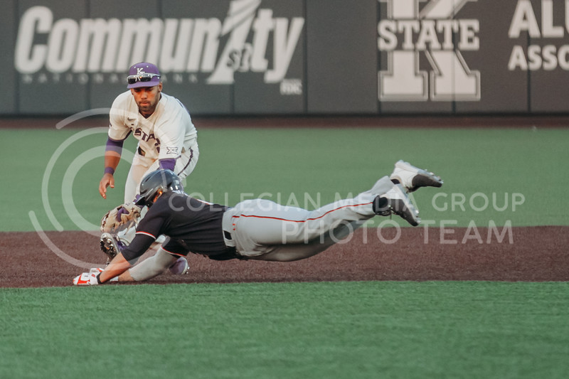 Sophomore Daniel Carinci looks to tag a diving player out during the first game against Texas Tech on April 1, 2021. (Sophie Osborn   Collegian Media Group)