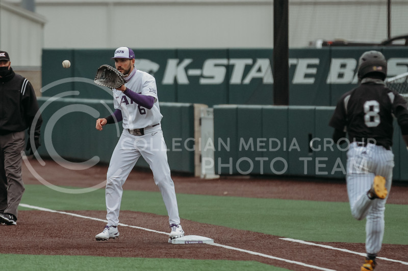 Junior Terrence Spurlin catches the ball to get a runner out during the April 7, 2021 game against Arkansas-Pine Bluff at Tointon Family Stadium. (Sophie Osborn | Collegian Media Group)