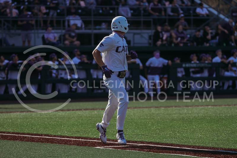 Junior Zach Kokoska runs toward first base during the game against West Virginia on April 24, 2021 at Tointon Family Stadium. (Sophie Osborn | Collegian Media Group)