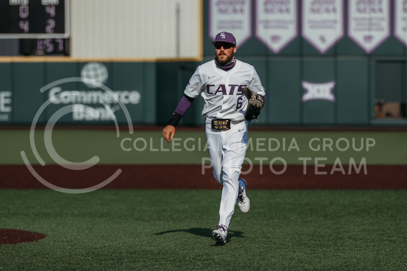Junior Terrence Spurlin runs toward the dugout in between innings during the game against West Virginia on April 24, 2021 at Tointon Family Stadium. (Sophie Osborn | Collegian Media Group)