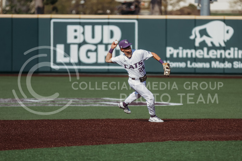 Freshman Nick Goodwin gets ready to throw the ball to first base during the game against West Virginia on April 24, 2021 at Tointon Family Stadium. (Sophie Osborn | Collegian Media Group)
