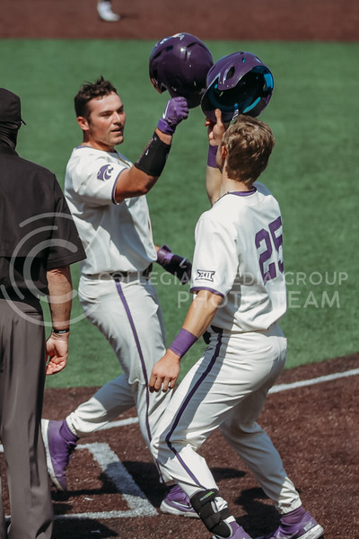 Sophomore Dylan Phillips celebrates a homerun with teammate during the game against West Virginia on April 25, 2021 at Tointon Family Stadium. (Sophie Osborn   Collegian Media Group)
