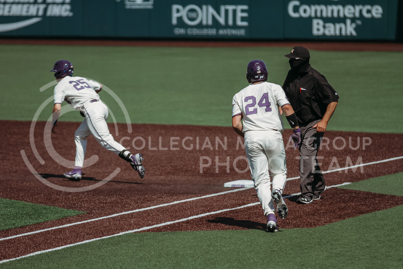 Sophomore Dylan Phillips makes it to first base as teammate Freshman Nick Goodwin books it to second base during the game against West Virginia on April 25, 2021 at Tointon Family Stadium. (Sophie Osborn   Collegian Media Group)