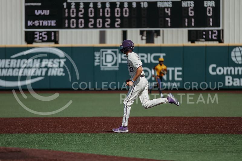 Senior Caleb Littlejim runs to second base during the game against West Virginia on April 25, 2021 at Tointon Family Stadium. (Sophie Osborn   Collegian Media Group)