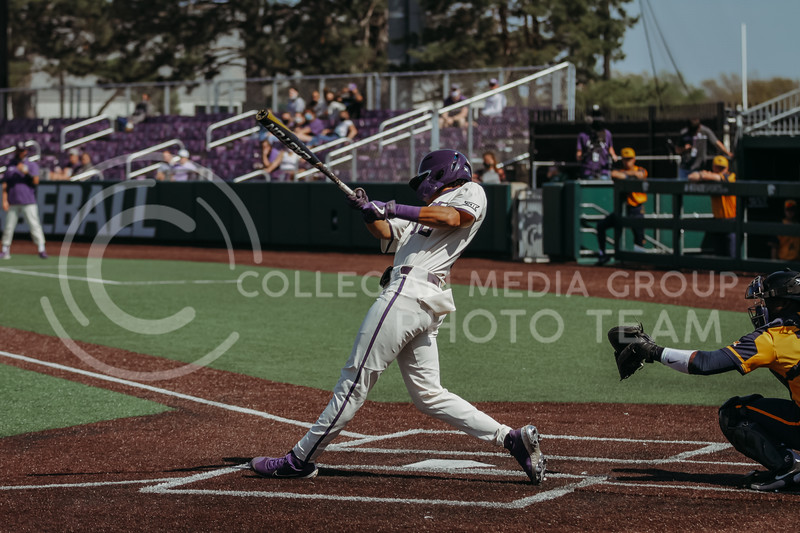 Junior Kamron Willman swings during the game against West Virginia on April 25, 2021 at Tointon Family Stadium. (Sophie Osborn   Collegian Media Group)