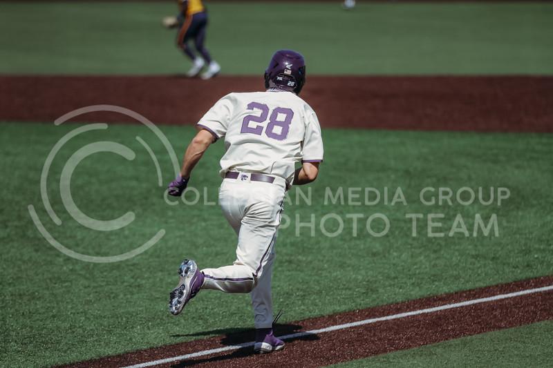 Junior Zach Kokoska runs to first base during the game against West Virginia on April 25, 2021 at Tointon Family Stadium. (Sophie Osborn   Collegian Media Group)