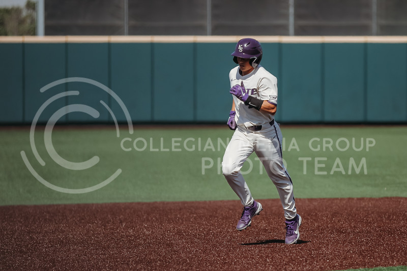 Junior Dylan Caplinger runs to the next base during the game against West Virginia on April 25, 2021 at Tointon Family Stadium. (Sophie Osborn   Collegian Media Group)