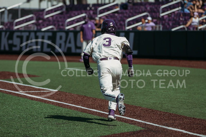 Senior Cameron Thompson runs to first base during the game against West Virginia on April 25, 2021 at Tointon Family Stadium. (Sophie Osborn   Collegian Media Group)