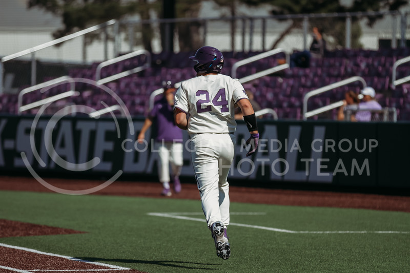 Sophomore Dylan Phillips runs to first base during the game against West Virginia on April 25, 2021 at Tointon Family Stadium. (Sophie Osborn   Collegian Media Group)