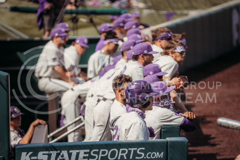 Players in the dugout watch during the game against West Virginia on April 25, 2021 at Tointon Family Stadium. (Sophie Osborn   Collegian Media Group)