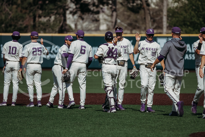 Teammates exchange high-fives after winning the game against West Virginia on April 25, 2021 at Tointon Family Stadium. (Sophie Osborn   Collegian Media Group)