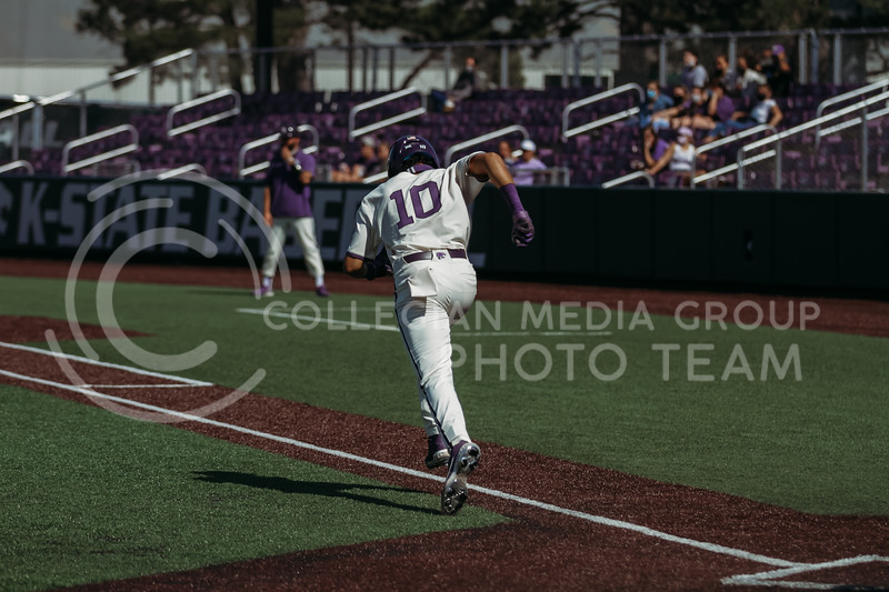 Junior Kamron Willman hustles to first base during the game against West Virginia on April 25, 2021 at Tointon Family Stadium. (Sophie Osborn   Collegian Media Group)