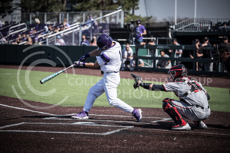 Freshman Dom Hughes up to bat and swinging on Friday's game (April 3, 2021) against Texas Tech at Tointon Stadium. <br /> Elizabeth Proctor Collegian Media Group