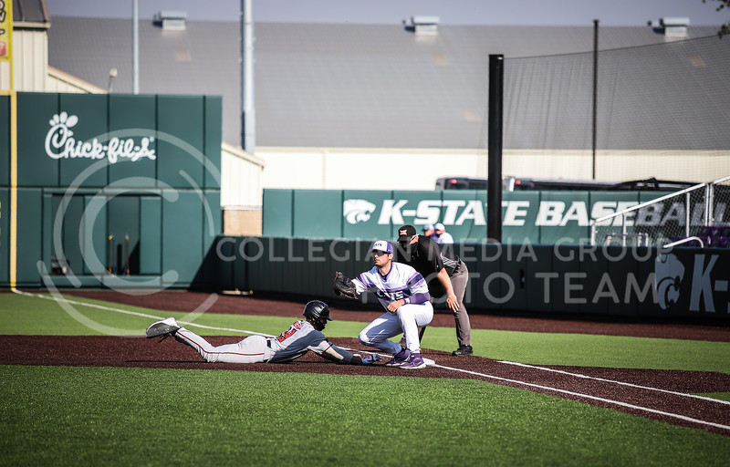 First baseman Cole Stilwell securing an out on Friday's game (April 3, 2021) against Texas Tech at Tointon Stadium. <br /> Elizabeth Proctor Collegian Media Group
