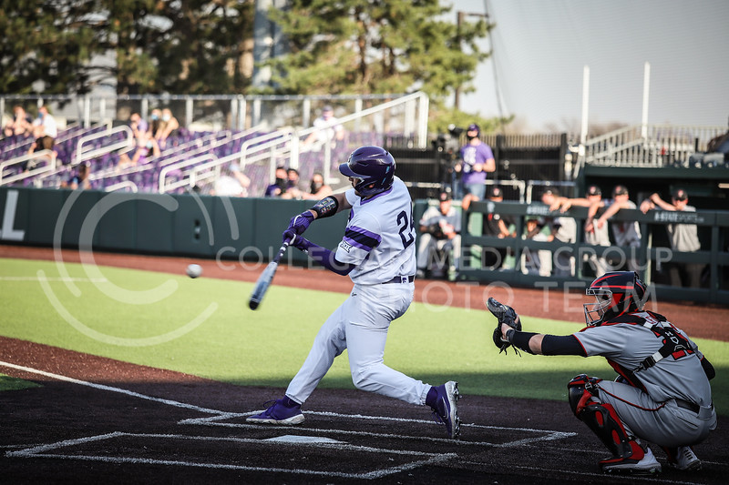Sophomore Dylan Phillips up to bat and swinging on Friday's game (April 3, 2021) against Texas Tech at Tointon Stadium. <br /> Elizabeth Proctor Collegian Media Group