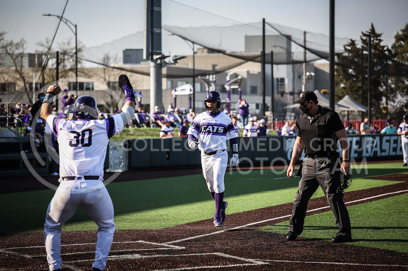 Senior Cameron Thompson running to home bringing in yet another run on Friday's game (April 3, 2021) against Texas Tech at Tointon Stadium. <br /> Elizabeth Proctor Collegian Media Group