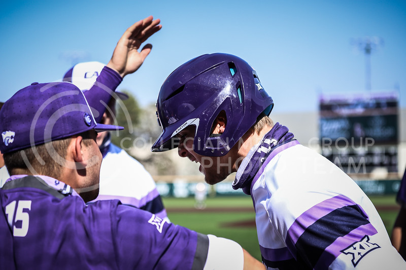 Freshman Nick Goodwin celebrating with his teammates after bringing in another run on Friday's game (April 3, 2021) against Texas Tech. <br /> Elizabeth Proctor Collegian Media Group