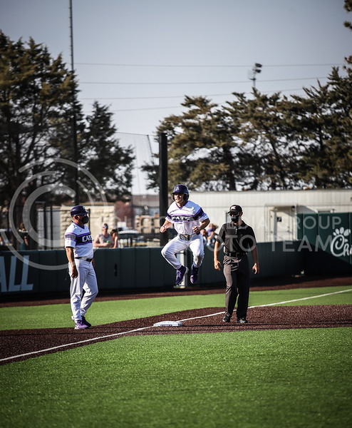 Senior Cameron Thompson getting hype on third base on Friday's game (April 3, 2021) against Texas Tech at Tointon Stadium. <br /> Elizabeth Proctor Collegian Media Group