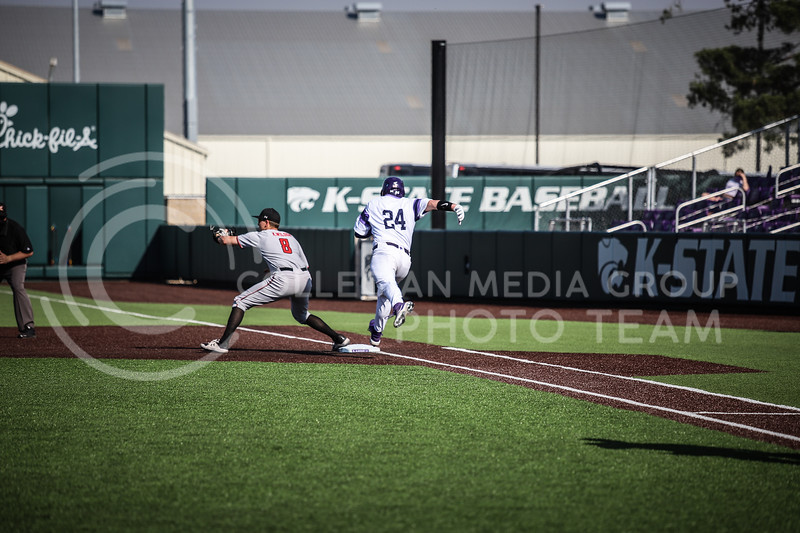 Sophomore Dylan Phillips running to first base on Friday's game (April 3, 2021) against Texas Tech.<br /> Elizabeth Proctor Collegian Media Group