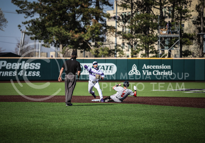 ......  assisting in a double play and throwing it to first base on Friday's game (April 3, 2021) against Texas Tech.<br /> Elizabeth Proctor Collegian Media Group