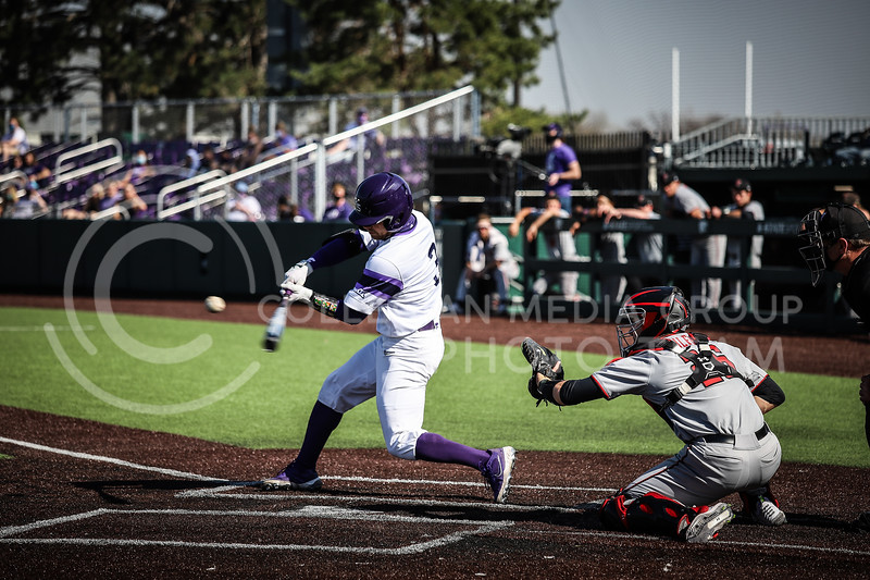Senior Cameron Thompson up to bat and swinging on Friday's game (April 3, 2021) against Texas Tech.<br /> Elizabeth Proctor Collegian Media Group